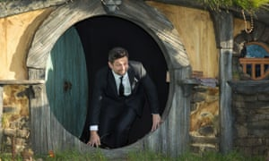 Andy Serkis, who plays Gollum, comes out of the hobbit's home during the film premiere for The Hobbit - An Unexpected Journey in Wellington, New Zealand.