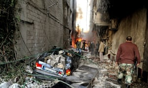 Syrian citizens inspecting the scene of a car bomb attack in Jaramana of Druze majority in Rural Damascus, Syria. Terrorists set off two explosions that left several people dead and many wounded.