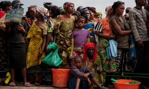 Families queue up to receive food rations at Don Bosco Orphanage in Goma, Democratic Republic of Congo. Rebels widely believed to be backed by Rwanda claimed control of Goma forcing thousands of people, already displaced by years of fighting to flee their homes again.