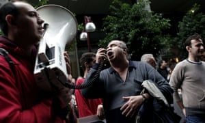 A blind demonstrator shouts slogans againts austerity measures outside the Finance Ministry in Athens.
