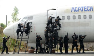 Action men: Police participate in a security drill at the Manila International Airport. The drill is part of the security plan in anticipation of a possible rise in crimes during the coming Christmas season.