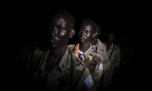 Somali National Army troops line up in the middle of the night ahead of a ground advance as part of a joint mission with the African Union Mission in an area south-west of the Somali capital. Troops from both the Ugandan and Burundian contingents advanced on foot to the dense area of bush that was previously occupied by the Al-Qaeda-affiliated terrorist group Al Shabaab.