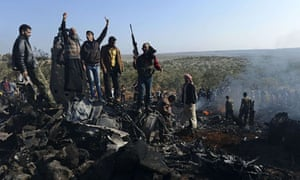 Syrian rebels amid the wreckage of a government jet