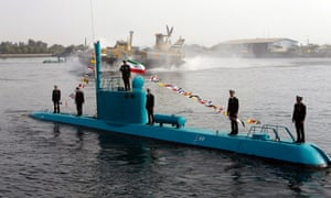 Iranian naval officers unveil a Ghadir-class submarine during a ceremony in the southern port city of Bandar Abbas.