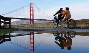 A couple ride a tandem towards the Golden Gate Bridge in San Francisco.
