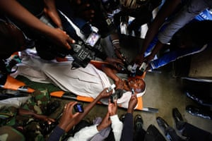 24 hours in pictures: Journalists interview a wounded FDLR rebel fighter