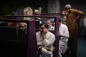 24 hours in pictures: Pakistani stockbrokers watch share prices