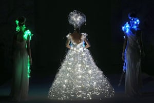 24 hours in pictures: A model showcases a wedding dress that lights up