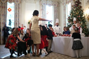 24 hours in pictures: Michelle Obama hosts an Christmas event