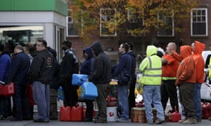 People line up for gasoline in New York amid shortages in the aftermath of Sandy