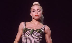 Madonna performing on her Blonde Ambition tour in 1990
