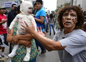 Zombie walk: A woman and a baby take part