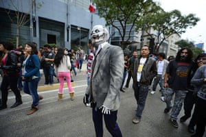 Zombie walk: A man dressed up as a zombie takes part