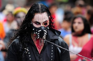 Zombie walk: A man is walked through the city on a lead