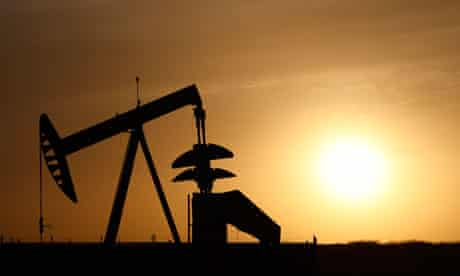 A pumpjack silhouetted