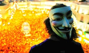 An Occupy protester wearing a V For Vendetta mask, designed by Alan Moore, in Madrid
