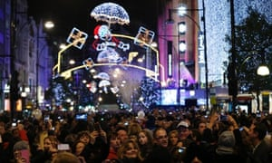 Merry shopping: A crowd watches the Oxford Street Christmas lights being switched on in central London.