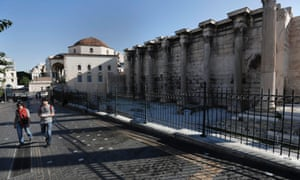 A couple of tourists walk past the closed Hadrian's Library archaeological site in Athens November 6, 2012.