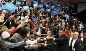 President Barack Obama greets supporters as he arrives at a campaign rally in Cincinnati, Ohio, on 4 November, 2012.