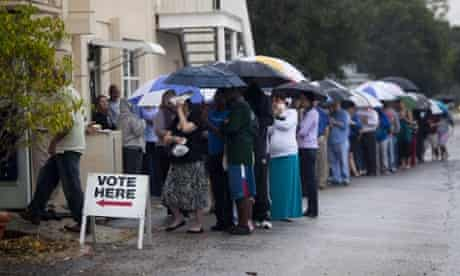 Lines of voters wait in the rain to cast their vote on election day 2012 in St Petersburg, Florida.