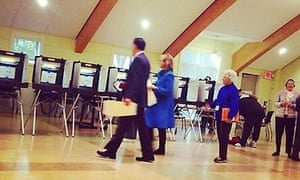 Mitt and Ann Romney arrive at their polling station in Belmont, Massachusetts, in a photo by Ari Shapiro of NPR.