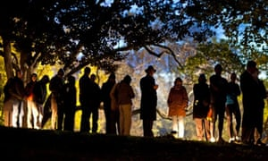 Virginia residents wait in line in the early hours to vote in the at Nottoway Park in Vienna, Virginia
