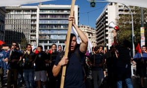 People chant slogans during protest in the center of Athens.