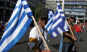 Protesters march outside parliament during a rally on November 6, 2012 in Athens, Greece.