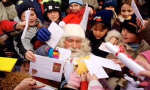 Santa being given Christmas lists