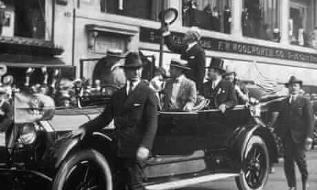 1916:  US president Woodrow Wilson waves from his car