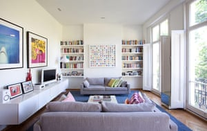Homes: Little Venice: Living room with paintings on white walls and a grey sofa