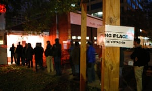 People queue up to early vote outside a polling station in Arlington Virginia.