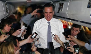 Mitt Romney talks with members of the traveling press aboard his campaign plabe on 6 November, 2012 en route to Boston, Massachusetts.