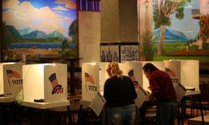 People vote at a polling place inside El Gallo restaurant in El Mercado de Los Angeles, a Mexico-style marketplace in the heavily Latino East LA area.