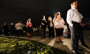 People queue in the dark to cast their ballots beore the 7pm deadline in Miami, Florida. The vote in this swing state could be crucial to the election result.