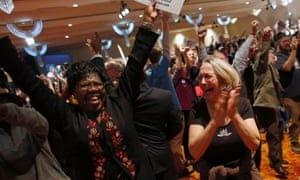 Supporters cheer after Barack Obama's projected win is announced during an election night event for Senate candidate Tammy Baldwin in Madison, Wisconsin.