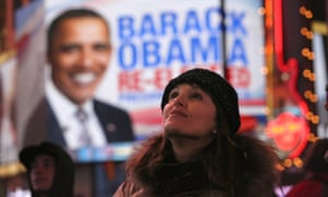 People watch election results in Times Square after television networks called the election in favor of President Barack Obama.