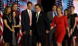 Mitt Romney, his wife Ann and family walk off of stage after his concession speech in Boston.