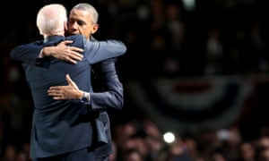 Barack Obama andVice President Joe Biden embrace on stage after his victory speech.
