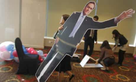 A woman carries a cardboard picture of Mitt Romney after the an election watch event in Seoul, South Korea.