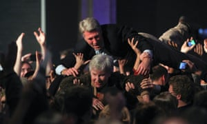 The mayor of Minneapolis, RT Rybak, crowdsurfing with his mother Loraine in celebration of Barack Obama's election victory on 6 November 2012.