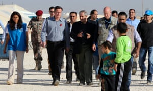 David Cameron tours Jordan's Zaatari camp for Syrian refugees with Jordanian foreign minister Nasser Judeh (and United Nations High Commissioner for Refugees representative to Jordan Andrew Harper.