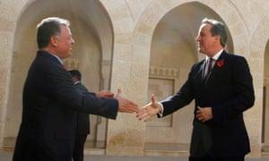 Jordan's King Abdullah greets David Cameron  Royal Palace in Amman.