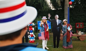 US citizen Heidi Molback next to a cutout of President Barack Obama by the US Embassy in New Delhi, India.