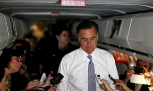 Republican presidential candidate Mitt Romney talks with members of the press aboard his campaign plane.
