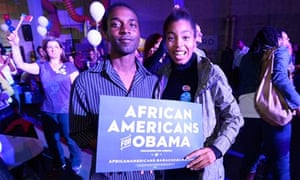 Supporters hold an 'African Americans for Obama' sign as they celebrate his re-election