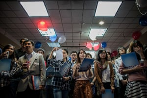 World election reaction: Hong Kong: Students watch the broadcast oat the US consulate