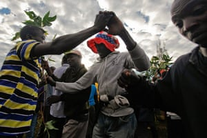 World election reaction: Kogelo, Kenya: Supporters dance after watching the news coverage