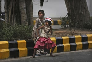 World election reaction: New Delhi, India: A young Indian girl dances outside the US embassy
