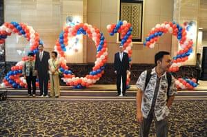 World election reaction: Jakarta, Indonesia: People pose next to the life size Barack Obama